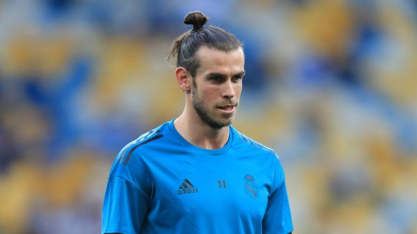 Gareth Bale practices with Real Madrid after missing training in Germany.