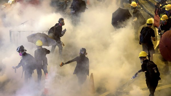 Hong Kong protesters tear gassed and forced to change locations