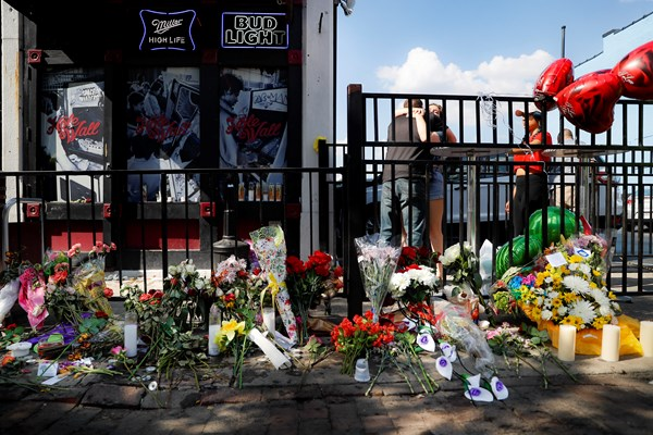 Mourners create a memorial at the scene of Dayton, Ohio shooting.